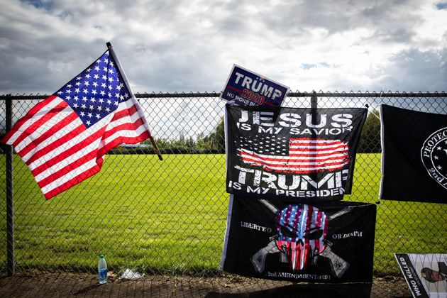 Flags are draped along a fence at a Proud Boys rally at Delta Park in Portland, Oregon on September 26,...