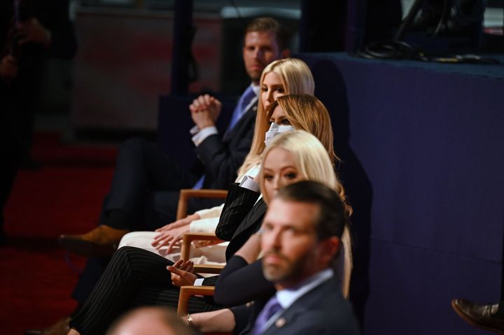 Members of the Trump family seen not wearing masks during the first presidential debate. Only first lady Melania Trump is wearing one.
