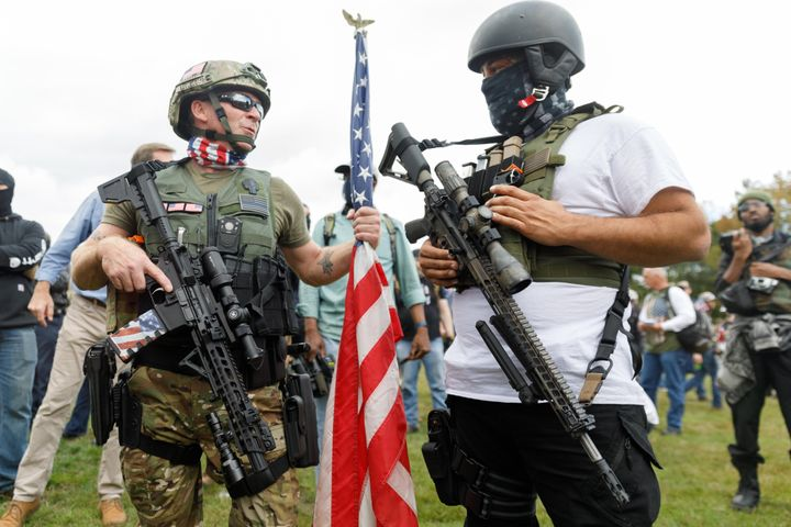 Heavily armed members of the far-right Proud Boys gang gather with their allies in Portland, Oregon, on Sept. 26.