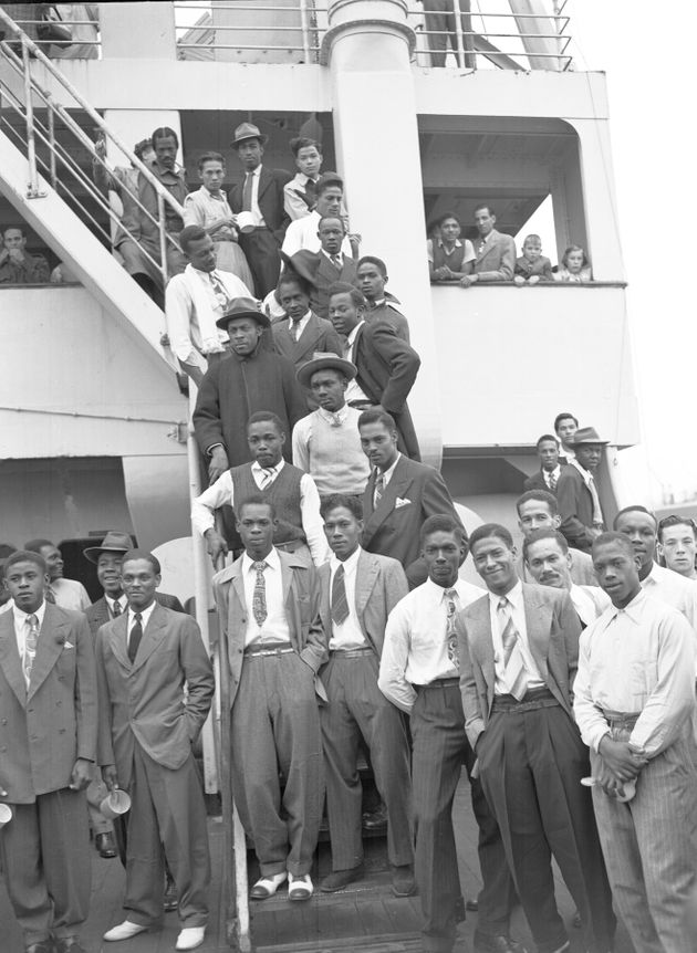 Some of the Jamaican men, mostly ex Royal Air Force servicemen, aboard the former troopship, S.S. Empire Windrush, before disembarking at Tilbury Docks, England, on June 22, 1948. They have come to Britain seeking employment. (AP Photo/Staff/Worth)