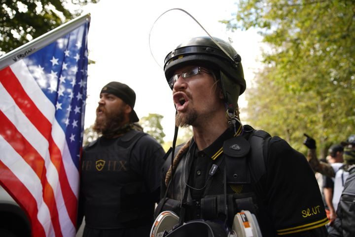 Members of the Proud Boys and other right-wing demonstrators rally on Saturday, Sept. 26, 2020, in Portland, Ore. (AP Photo/A