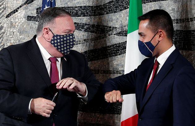 U.S. Secretary of State Mike Pompeo bumps elbows with Italian Foreign Minister Luigi Di Maio at the end...