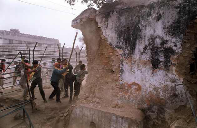 In this December 6, 1992 photograph, Hindu mob attacks the wall of the 16th century Babri Masjid Mosque...