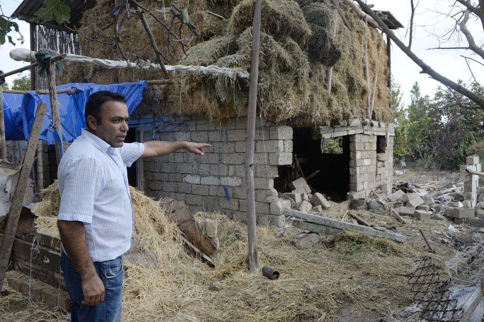 Une maison qui aurait été endommagéepar les bombardements lors des combats...