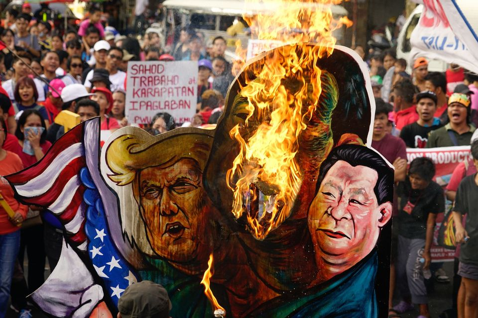 Protesters groups burn an effigy of Duterte, Trump and Chinese president Xi