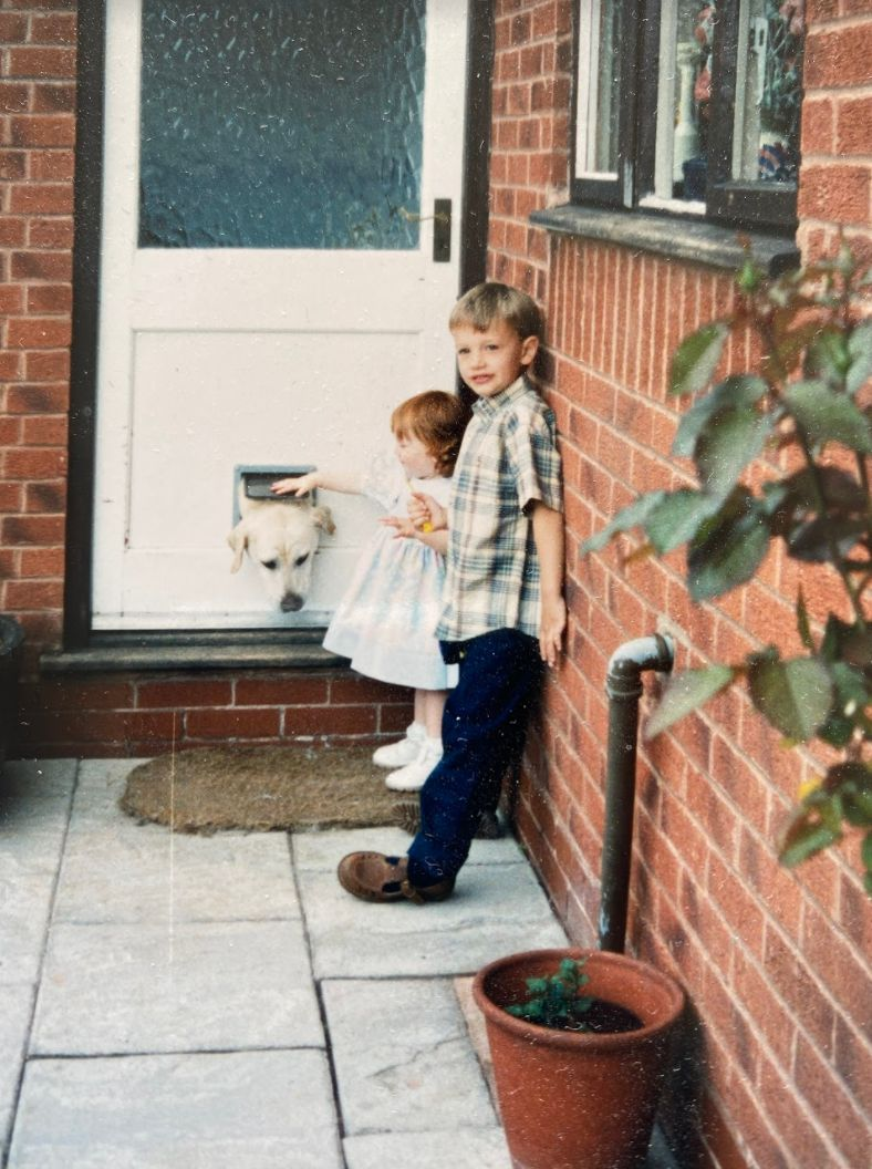 Charlotte and James as young children with their first dog, Major.