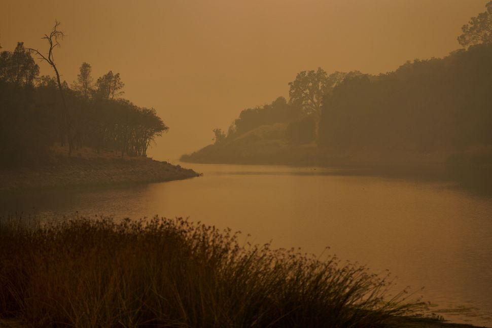 Smoke lingers over Lake Hennessey in Napa County on Wednesday.
