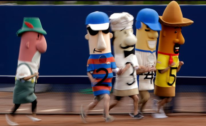 These are the sausage mascots that the Wisconsin GOP wants to keep away from polling sites.
