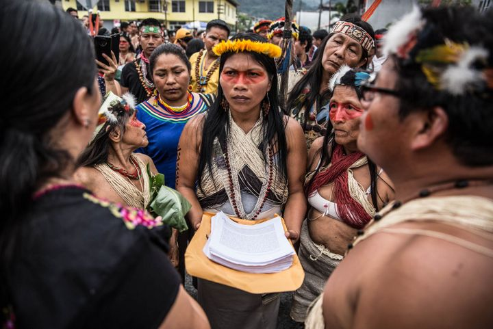 Nemonte Nenquimo holds the Waorani people's written demands to stop oil extraction in their territory at a February 2019 prot
