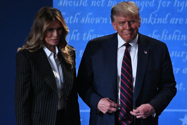 US President Donald Trump and US First Lady Melania Trump leave after the first presidential debate at...