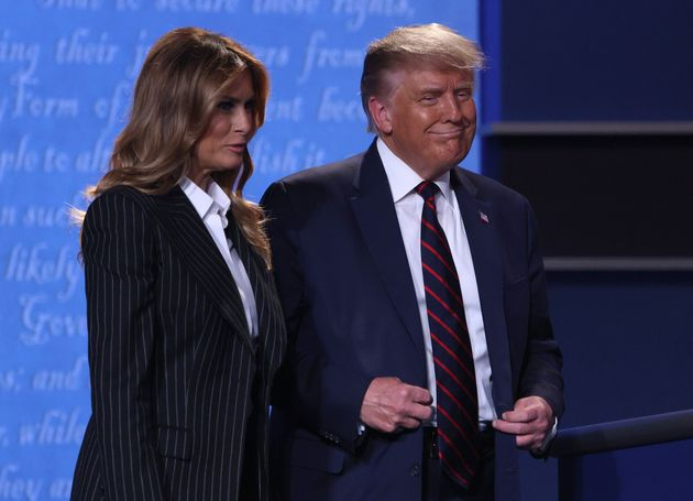 US President Donald Trump and first lady Melania Trump smile on stage after the first presidential debate...