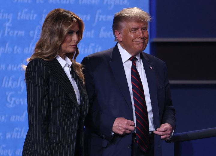 US President Donald Trump and first lady Melania Trump smile on stage after the first presidential debate between Trump and Democratic presidential nominee Joe Biden at the Health Education Campus of Case Western Reserve University on September 29, 2020 in Cleveland, Ohio.