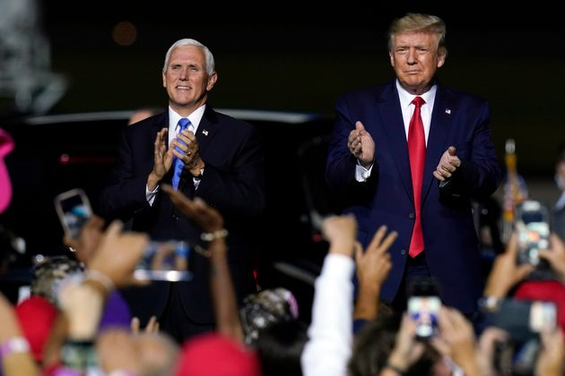 Trump and vice president Mike Pence, who has tested negative, arrive at a campaign rally in Newport