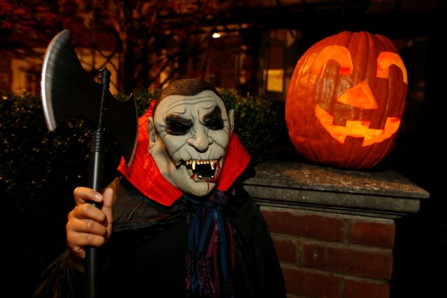 Teenager playing trick or treat in London on Halloween night,