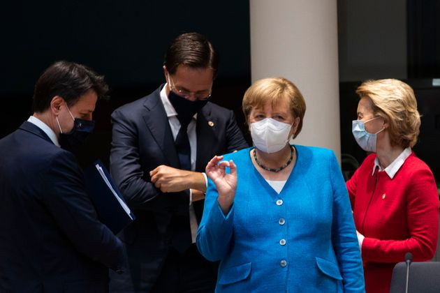 German Chancellor Angela Merkel ( 2nd R) gestures next to Italy's Prime Minister Giuseppe Conte (L),...