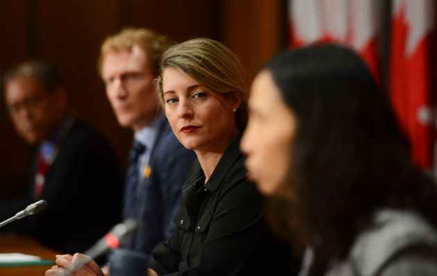 Economic Development Minister Melanie Joly, second from left, takes part in a press conference on Parliament...