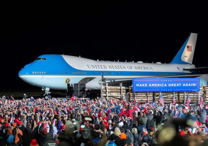 The crowd cheers as Air Force One arrives with President Donald Trump at Duluth International Airport on Wednesday, Sept. 30,
