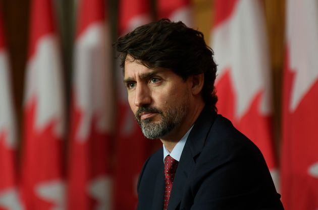 Prime Minister Justin Trudeau surveys the room as he listens to speakers during a news conference in...