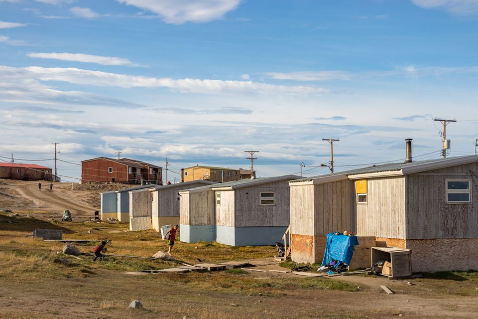 File photo of residential wooden houses on a dirt road in Pond Inlet, Baffin Island on Aug. 23,