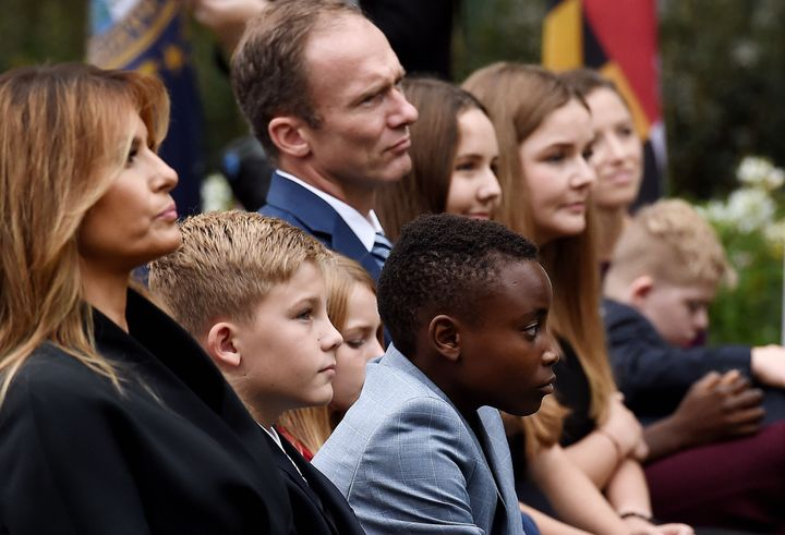 First lady Melania Trump sits with the husband of Judge Amy Coney Barrett, Jesse Barrett, and some of the Barrett children in the White House Rose Garden as President Donald Trump announces Barrett's nomination to the Supreme Court. Trump and the first lady tested positive for COVID-19 days later.