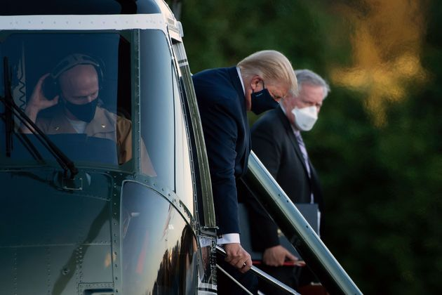 Donald Trump steps off Marine One while arriving at Walter ReedNational MilitaryMedical Center...