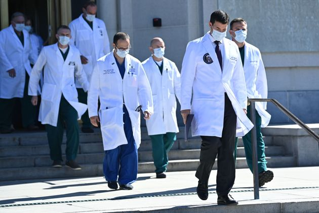 White House physician Sean Conley (2nd R), with medical staff, arrives to give an update on the condition of Donald Trump.