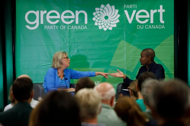 Green Party of Canada leader Elizabeth May, left, speaks with Toronto area leadership candidate Annamie...