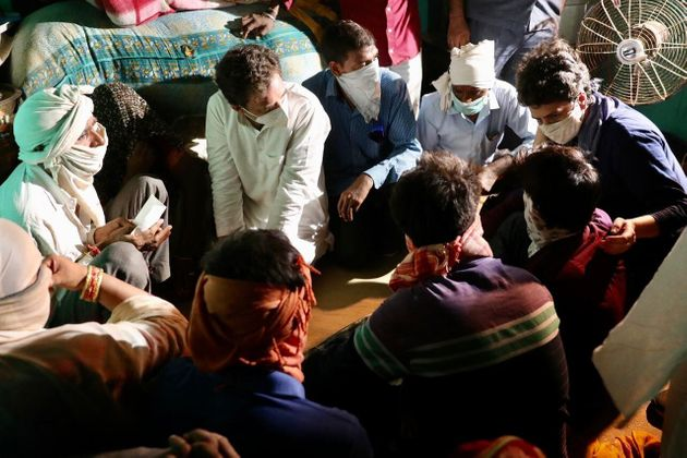 Hathras family meeting the Gandhis at their home on