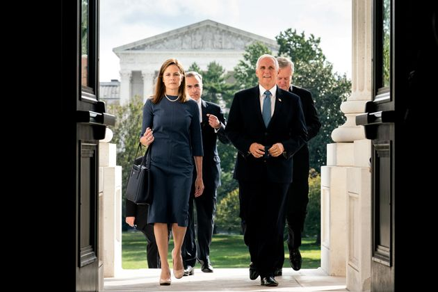 Judge Amy Coney Barrett, U.S. President Donald Trump's nominee to the Supreme Court, and Vice President...