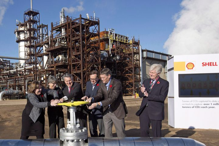 Royal Dutch Shell and other oil company executives and then-Alberta energy minister Marg McCuaig-Boyd (left) open the valve to a carbon capture and storage facility in Fort Saskatchewan, Alta., on Nov. 6, 2015.