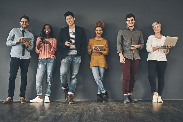 Studio shot of a diverse group of creative employees social networking