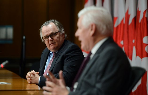 Marc-Andre Blanchard looks towards Bob Rae as he speaks during a press conference regarding his appointment...