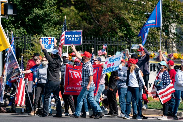 A a group consisting largely of Trump supporters gathers outside Walter Reed National Military Medical Center in Maryland on
