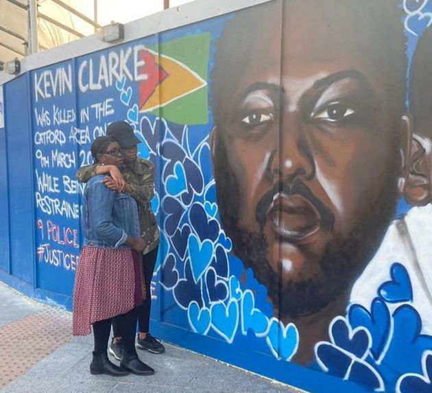 Wendy Clarke, Kevin's mother, and his sister Tellecia at a mural of Kevin Clarke in Lewisham