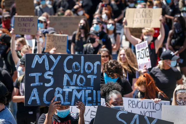 Protesters in Calgary demonstrate in solidarity with with the George Floyd protests across the United...