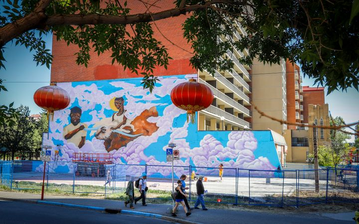 """""""The Guide and Protector"""" in progress on Sept. 10, 2020. The mural is across the street from Calgary Chinese Cultural Centre."""