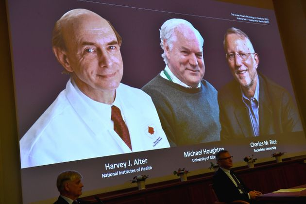 ScientistsHarvey J. Alter, Michael Houghton and Charles M. Rice appear on a screen as they're announced...