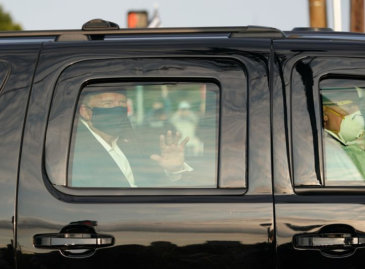 President Donald Trump's armored SUV drives past supporters in a motorcade outside of Walter Reed National Military Medical C