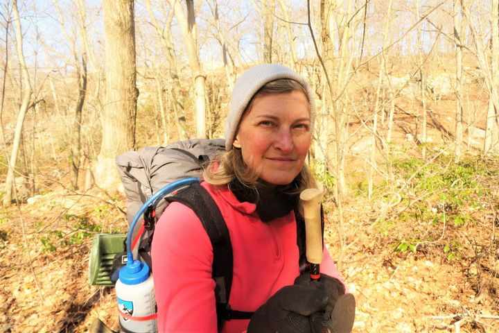 Stephanie Joyner hiking the Appalachian Trail in New York two weeks before becoming infected with the coronavirus. It shows ""