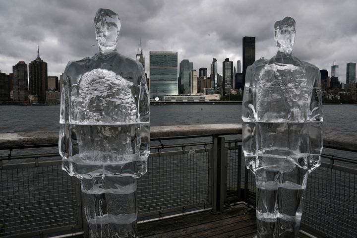 Two ice sculptures depicting U.S. President Donald Trump and Brazilian President Jair Bolsonaro sit across the Hudson River f