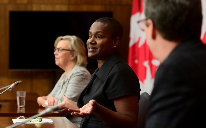 New Green Party Leader Annamie Paul, middle, holds a press conference alongside Green Party government house leader Elizabeth May, left, and Green MP Paul Manly in Ottawa on Oct. 5, 2020.