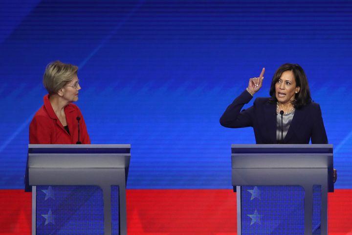 Sen. Elizabeth Warren looks on as Harris speaks during the Democratic Presidential Debate on Sept. 12, 2019, in Houston, Texas.