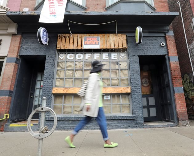 A shuttered coffee shop on Queen Street East in Toronto is seen on May 15,