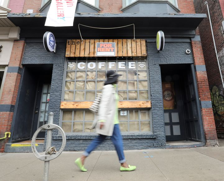 A shuttered coffee shop on Queen Street East in Toronto is seen on May 15, 2020.