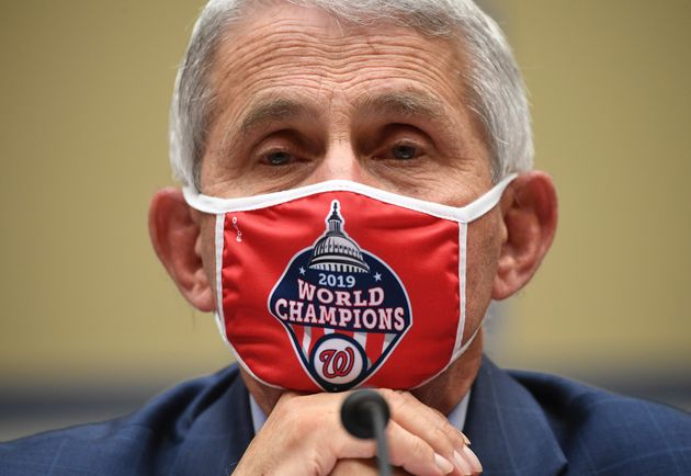 Dr. Anthony Fauci, director of the National Institute for Allergy and Infectious Diseases, listens during...