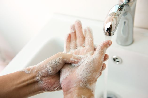 Washing of hands with soap under running