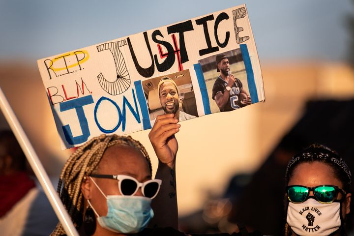 People gather for a march, rally and candle light vigil in honor Jonathan Price on October 5, 2020 in Wolfe City, Texas. (Pho