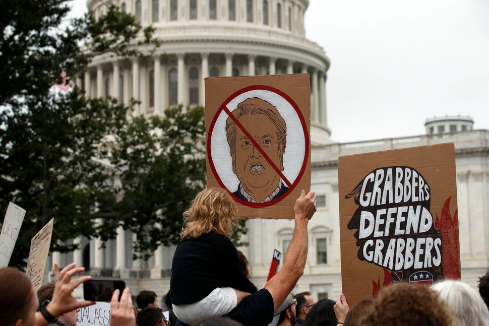 Demonstrators gather outside the U.S. Capitol to protest the confirmation vote for Supreme Court nominee Brett Kavanaugh in 2