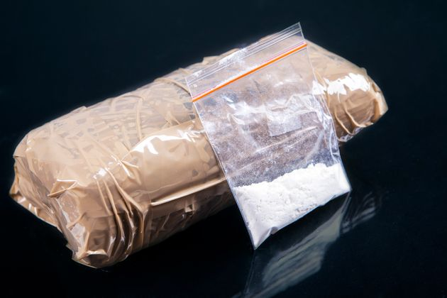 Cocaine powder in plastic bag with a