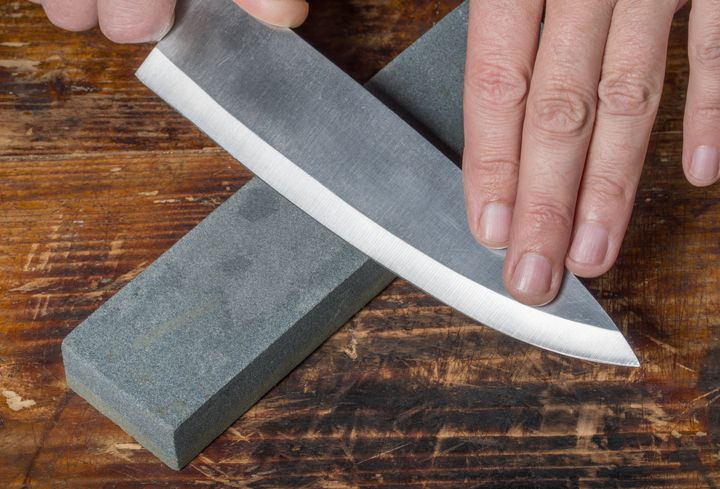 A whetstone is the ideal tool for sharpening the blade of a chef's knife.